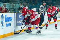 KAMLOOPS, CANADA - NOVEMBER 5:  Kirill Slepets #32 of Team Russia checks Bowen Byram #44 of Team WHL on November 5, 2018 at Sandman Centre in Kamloops, British Columbia, Canada.  (Photo by Marissa Baecker/Shoot the Breeze)