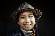 Cambodia, Siem Reap. Young Khmer woman smiling widely.