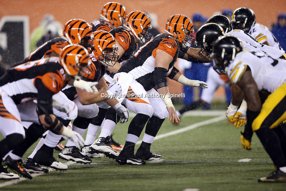 The Cincinnati Bengals offensive line snaps the ball opposite the Pittsburgh Steelers defensive line during the NFL AFC Wild Card playoff football game against the Pittsburgh Steelers on Saturday, Jan. 9, 2016 in Cincinnati. The Steelers won the game 18-16. (©Paul Anthony Spinelli)