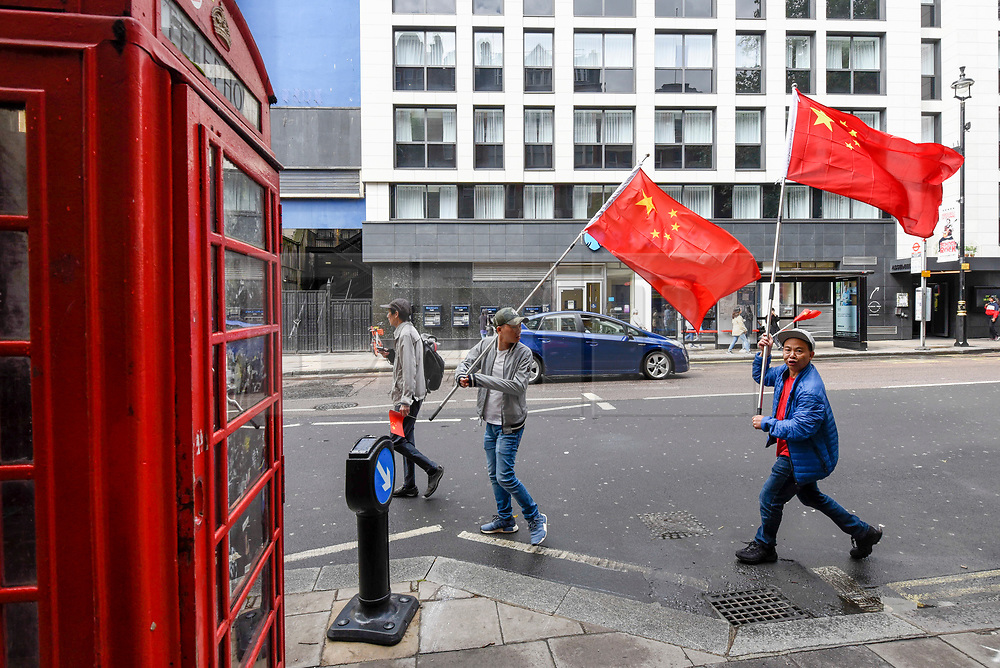 © Licensed to London News Pictures. 18/08/2019. LONDON, UK.  Members of the capital's Chinese community march down Charing Cross Road waving Chinese flags during a rally of support for the people of Hong Kong and for China.  They are calling for an end to police violence and a respect for law as protests in the former British colony enter their eleventh week.  Photo credit: Stephen Chung/LNP