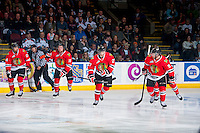 KELOWNA, CANADA - APRIL 18: Mathew Dumba #24, Garrett Haar #18, Oliver Bjorkstrand #27 and Chase De Leo #9 of the Portland Winterhawks skate to the bench to celebrate a goal against the Kelowna Rockets on April 18, 2014 during Game 1 of the third round of WHL Playoffs at Prospera Place in Kelowna, British Columbia, Canada.   (Photo by Marissa Baecker/Shoot the Breeze)  *** Local Caption *** Mathew Dumba; Garrett Haar; Oliver Bjorkstrand; Chase De Leo;