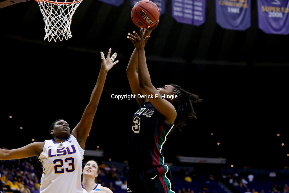 Mar 24, 2013; Baton Rouge, LA, USA; Green Bay Phoenix forward Breannah Ranger (3) shoots over LSU Tigers forward Shanece McKinney (23) in the second half of the first round of the 2013 NCAA womens basketball tournament at the Pete Maravich Assembly Center.  LSU defeated Green Bay 75-71. Mandatory Credit: Derick E. Hingle-USA TODAY Sports