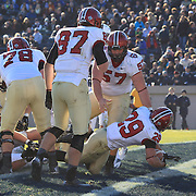 Paul Stanton, (twenty-nine), Harvard, scores one of his four touchdowns during the Yale V Harvard, Ivy League Football match at Yale Bowl. Harvard won the game 34-7 giving Harvard a share of the 2013 Ivy League title.  The game was the 130th meeting between Harvard and Yale in the historic rivalry that dates back to 1875. New Haven, Connecticut, USA. 23rd November 2013. Photo Tim Clayton