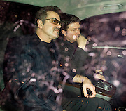 15.OCTOBER.2009 - LONDON<br /> <br /> GEORGE MICHAEL AND PARTNER KENNY GOSS ARRIVING AT NOBU RESTAURANT, BERKLEY SQUARE WITH GEORGE SHOWING OFF HIS WEDDING RING. THEY STAYED AT NOBU TILL 11.30PM BEFORE LEAVING AND HAD A GIGGLE IN THE CAR AS THEY LEFT.<br /> <br /> BYLINE: EDBIMAGEARCHIVE.COM<br /> <br /> *THIS IMAGE IS STRICTLY FOR UK NEWSPAPERS & MAGAZINES ONLY*<br /> *FOR WORLDWIDE SALES & WEB USE PLEASE CONTACT EDBIMAGEARCHIVE-0208 954 5968*