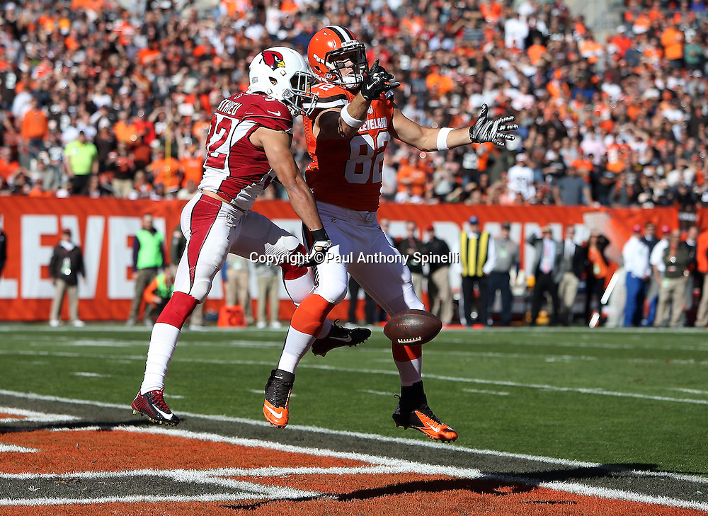 Arizona Cardinals free safety Tyrann Mathieu (32) jumps in the air as he breaks up an end zone pass intended for Cleveland Browns tight end Gary Barnidge (82) in the first quarter during the 2015 week 8 regular season NFL football game against the Cleveland Browns on Sunday, Nov. 1, 2015 in Cleveland. The Cardinals won the game 34-20. (©Paul Anthony Spinelli)