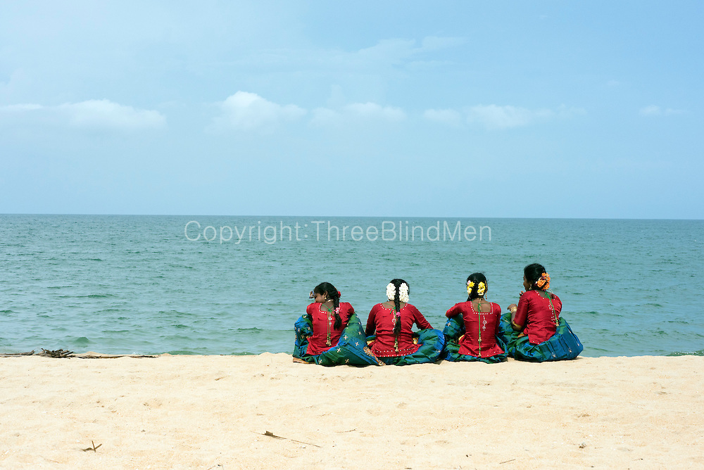 Children enjoy the beach before their final dance and ceremony on the beach at Udappu.