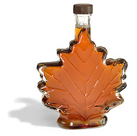 maple syrup in a leaf shape glass bottle