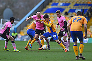 Northampton Town midfielder Jason Taylor  and Mansfield Town midfielder Jack Thomas during the Sky Bet League 2 match between Mansfield Town and Northampton Town at the One Call Stadium, Mansfield, England on 28 March 2016. Photo by Jon Hobley.