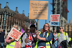 © Licensed to London News Pictures. 29/03/2019. London, UK. Pro-Brexit protesters rally in Parliament Square on 29 March 2019, the day on which the U. K. was supposed to leave the EU. MPs will vote on whether to accept Prime Minister Theresa May's withdrawal agreement for a third time today. Photo credit: Rob Pinney/LNP