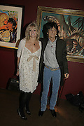 Jo Wood and Ronnie Wood, Ronnie Wood, private view. Scream, 34 Bruton Street, London, W1, 23 August 2006. ONE TIME USE ONLY - DO NOT ARCHIVE  © Copyright Photograph by Dafydd Jones 66 Stockwell Park Rd. London SW9 0DA Tel 020 7733 0108 www.dafjones.com