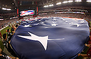 A large American flag is waved by holders during the playing of the National Anthem before during the Arizona Cardinals NFL week 1 regular season football game against the San Diego Chargers on Monday, Sept. 8, 2014 in Glendale, Ariz. The Cardinals won the game 18-17. ©Paul Anthony Spinelli