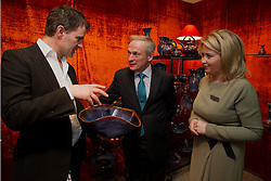 Repro Free: 20/01/2012.The Minister for Jobs, Enterprise and Innovation, Richard Bruton TD is pictured opening Showcase 2013, showcasing the best of fashion and homewear from leading Irish designers this week at Ireland's largest international trade fair pictured speaking with Colm de Rís of Colm de Rís Pottery (left) and Karen Hennesy, Chief Executive, Crafts Council of Ireland. Showcase takes place at the RDS from Sunday 20th to Wednesday 23rd January. For more information visit www.showcase .com. Picture Andres Poveda.