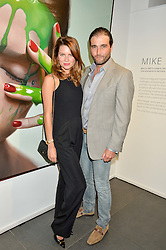 DAVID & GABRIELA PEACOCK at a private view of woks by German artist Mike Dargas held at the Opera Gallery, 134 New Bond Street, London on 5th July 2016.