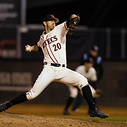 24 February 2018: The San Diego State Aztec baseball team competes in day two of the Tony Gwynn legacy tournament against #4 Arkansas. San Diego State Aztecs pitcher Ray Lambert (20) seen here in the top of the ninth inning with runners on base trailing Arkansas 4-2. The Aztecs dropped a close game to the Razorbacks 4-2. <br /> More game action at sdsuaztecphotos.com