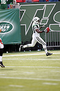 EAST RUTHERFORD, NJ - SEPTEMBER 12:  Defensive back Donnie Abraham #29 of the New York Jets scores a touchdown on an interception against the Cincinnati Bengals at Giants Stadium on September 12, 2004 in East Rutherford, New Jersey. The Jets defeated the Bengals 31-24. ©Paul Anthony Spinelli *** Local Caption *** Donnie Abraham