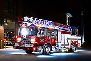 "In a composite ""light painting"" image created from stitching together 16 images in which an LED light was shined across portions of the image, Hanover Area Fire & Rescue's new Engine 79-2 sits on display in front of the Clover Lane station, Thursday, June 22, 2018 in Penn Township."