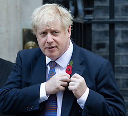 © Licensed to London News Pictures. 28/10/2019. London, UK. Prime Minister Boris Johnson pins a poppy to his jacket after purchasing it from The Royal British Legion Downing Street .  Photo credit: George Cracknell Wright/LNP