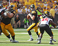 August 31 2013: Iowa Hawkeyes quarterback Jake Rudock (15) looks to pass during the second quarter of the NCAA football game between the Northern Illinois Huskies and the Iowa Hawkeyes at Kinnick Stadium in Iowa City, Iowa on August 31, 2013. Northern Illinois defeated Iowa 30-27.