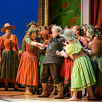 Picture shows : Nicholas Folwell as Mumlal with the chorus...Picture  ©  Drew Farrell Tel : 07721 ?735041.THE TWO WIDOWS by  Smetana.A SCOTTISH OPERA AND EDINBURGH INTERNATIONAL FESTIVAL CO-PRODUCTION.Premiering at the Edinburgh International Festival, this brand new production stars Scottish soprano Kate Valentine and internationally renowned mezzo Jane Irwin..The directorial partnership between Tobias Hoheisel and Imogen Kogge transforms this delicate comedy into something that digs deeper without losing its inherent charm. Francesco Corti conducts this, his first production as Music Director of Scottish Opera...Kate Valentine as Karolina Záleská.Jane Irwin as Ane?ka Miletinská?Nicholas Folwell as Mumlal?David Pomeroy as Ladislav Podhajsky?Ben Johnson as Toník, a peasant?Rebecca Ryan as Lidka, a maid.?Conductor..Francesco Corti.Directors ..         Tobias Hoheisel & Imogen Kogge.Designer..         Tobias Hoheisel.Lighting..         Peter Mumford.Choreographer  .Kally Lloyd-Jones.Dramaturg..Micaela von Marcard..Performances :.Edinburgh Festival Theatre?9 ? 11 ? 12  August?Theatre Royal, Glasgow?10 ?  14 ? 17 ? October?Note to Editors:  This image is free to be used editorially in the promotion of Scottish Opera and The Edinburgh International Festival. Without prejudice ALL other licences without prior consent will be deemed a breach of copyright under the 1988. Copyright Design and Patents Act  and will be subject to payment or legal action, where appropriate..Further further information please contact Kerryn Hurley Scottish Opera Press Manager t:   0141 242 0511. Or contact The Edinburgh International Festival Press Office  +44 (0)131 473 2020.