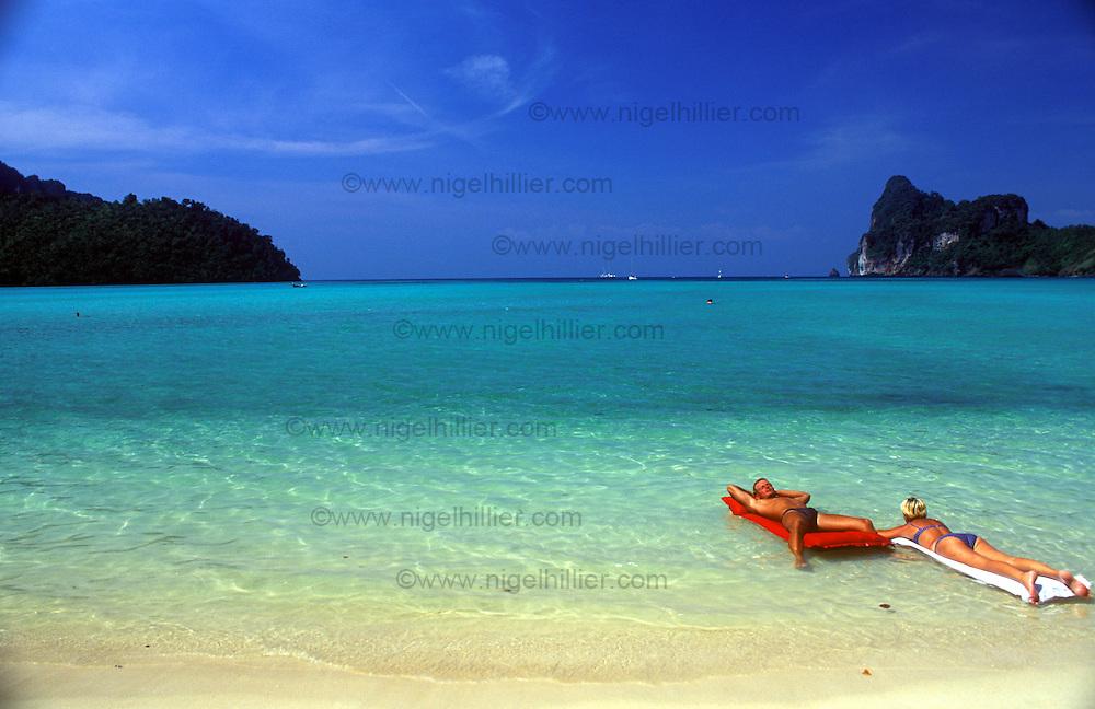 sunbathers,phi phi,thailand
