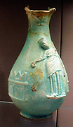 Faience oinochoai (jugs).  This type of jug was used in the cult of the Hellenistic queens of Egypt, who received divine honours in their own lifetime.  On each, the queen is shown pouring a libation at an altar, while behind her is a sacred pillar.  Ptolemy IV was the only male ruler to appear on the jugs, as seen in a fragment displayed alongside.