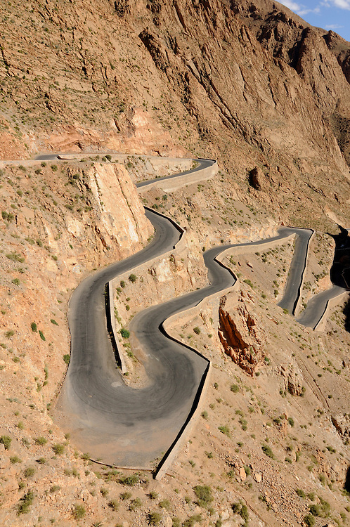 A serpentine road in the wilderness of the Dades gorge. Morocco. Africa.