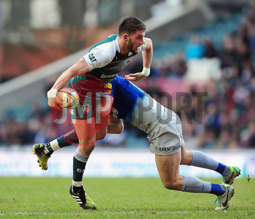 Owen Williams of Leicester Tigers looks to offload the ball - Mandatory byline: Patrick Khachfe/JMP - 07966 386802 - 20/03/2016 - RUGBY UNION - Welford Road - Leicester, England - Leicester Tigers v Saracens - Aviva Premiership.