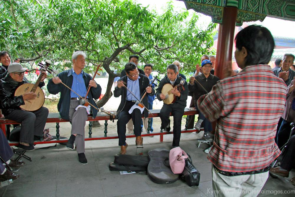 Asia, China, Beijing. Musicians practice in the Temple of Heaven Park in Beijing.