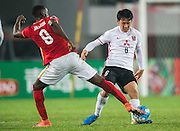 GUANGZHOU, CHINA - MARCH 16:  Endo Wataru of Urawa Red Diamonds (R) being followed by Jackson Martinez of Guangzhou Evergrande (L) during the AFC Champions League match between Guangzhou Evergrande and Urawa Red Diamonds on March 16, 2016 in Guangzhou, China.  (Photo by Aitor Alcalde Colomer/Getty Images)