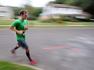 FEASTERVILLE, PA - SEPTEMBER 13:  John Bogucki Jr. #14 competes in the 5K portion of the 9/11 Heroes Run September 13, 2014 in Feasterville, Pennsylvania. Proceeds from the local event benefit the Travis Manion Foundation and the Lower Southampton Veterans Advisory Council. (Photo by William Thomas Cain/Cain Images)