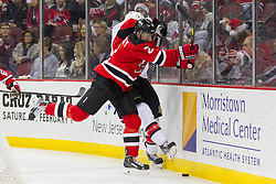 Dec 18, 2013; Newark, NJ, USA;  New Jersey Devils defenseman Marek Zidlicky (2) hits Ottawa Senators left wing Colin Greening (14) during the first period at the Prudential Center.