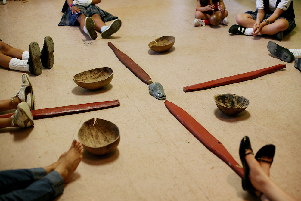 During a folklorico dance practice sit around coconut bowls and wooden pestles that were used to grind corn and other plants and vegetables for cooking, at the Instituto de Cultural Puertorriqueña, a cultural center in Jayuya, Puerto Rico, on Monday, November 17, 2008. Residents will celebrate the 39th annual Festival Indigena de Jayuya, which honors their Taino Indian heritage, this weekend.