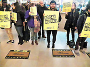 Today in New York City members of Amnesty International USA, held a rally at Grand Central Station as part of the No Ban! No Wall protest and vigils that have been taking place since President Trump issued a travel ban, around one hundered people took part in the action, holding signs that said no ban no wall and welcome mats on the floor that read immigrants welcome, the group wanted to   make sure that the people of New York and the US government hears them loud and clear. (Photo by Mark Apollo/Hashtag Occupy Media)