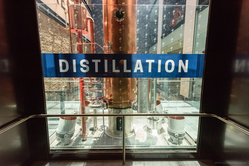 The elevator ride offers a view of the Distillation area and the 44 foot-tall column still made by Vendome Copper & Brass Works of Louisville, Ky., in the center of the view in the Old Forester Distilling Company on Whisky Row in Louisville, Ky. June 6, 2018