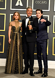 Natalie Portman and Timothee Chalamet present Taika Waititi with his Best Adapted Screenplay for Jojo Rabbit in the press room at the 92nd Academy Awards held at the Dolby Theatre in Hollywood, Los Angeles, USA.