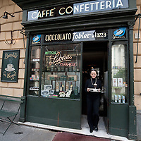 TURIN, ITALY - MAY 28:  Al Bicerin cafe, that created the historic hot drink from Turin, which is a mixture of espresso, drinking chocolate and fresh cream carefully layered in a glass on May 28, 2010 in Turin, Italy. The traditional recipe was created around 1750 in a cafe in front of the entrance of the Santuario della Consolata, where it is still served to this day.  (Photo by Marco Secchi/Getty Images)