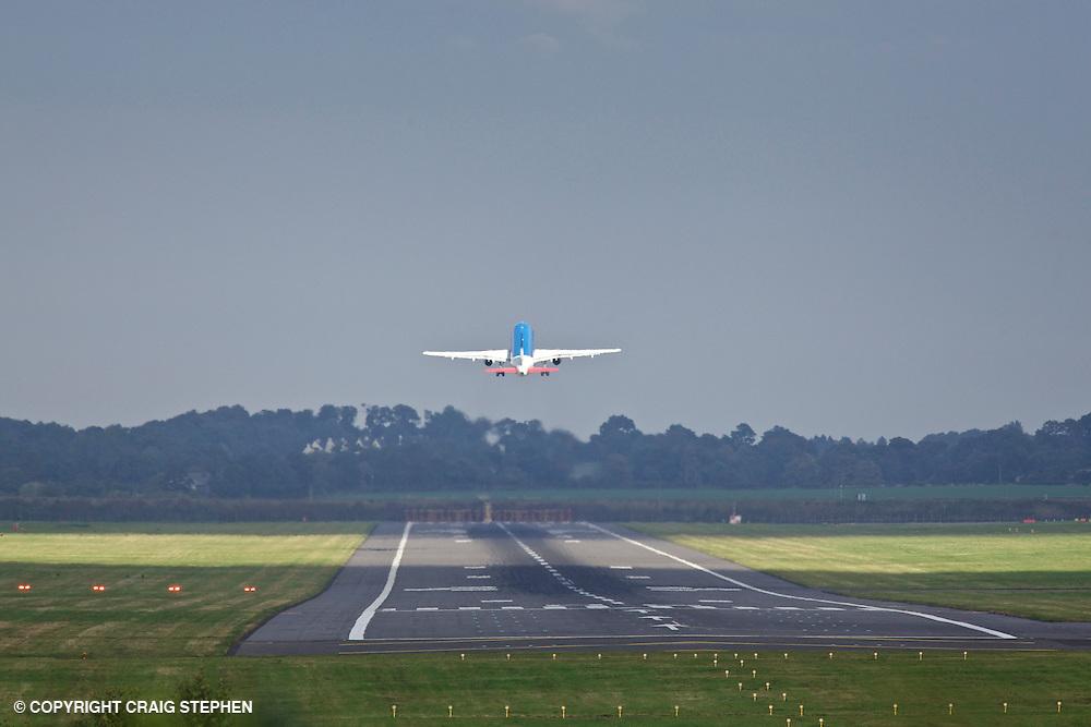 A plane taking off at Edinburgh airport, Scotland, UK