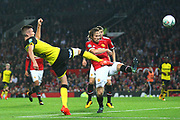Burton Albion midfielder Matthew Lund (8) shoots past Manchester United Midfielder Daley Blind during the EFL Cup match between Manchester United and Burton Albion at Old Trafford, Manchester, England on 19 September 2017. Photo by John Potts.