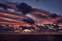 Colorful Dawn clouds over the Pacific Ocean from the deck of the MV World Odyssey. Image 3 of 6 taken with a  Fuji X-T1 camera and 23 mm f/1.4 lens (ISO 200, 23 mm, f/5.6, 1/60 sec). Raw images processed with Capture One Pro.