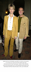 MISS NICOLA FORMBY and MR A A GILL at a party in London on 16th October 2001.	OTC 24
