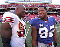 Oct 21, 2007: East Rutherford, NJ, USA: San Francisco 49ers defensive end (97) Bryant Young and New York Giants defensive end (92) Michael Strahan speak after the Giants defeat the 49ers 33-15 at Giants Stadium.