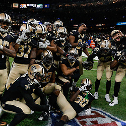 Dec 17, 2017; New Orleans, LA, USA; New Orleans Saints players celebrate a game ending interception by cornerback Marshon Lattimore during the fourth quarter against the New York Jets at the Mercedes-Benz Superdome. The Saints defeated the Jets 31-19. Mandatory Credit: Derick E. Hingle-USA TODAY Sports