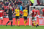 Bailey Wright (5) of Bristol City is shown a yellow card, booked for a challenge on Ivan Cavaleiro (7) of Wolverhampton Wanderers during the The FA Cup 5th round match between Bristol City and Wolverhampton Wanderers at Ashton Gate, Bristol, England on 17 February 2019.