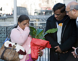 © Licensed to London News Pictures. 04/01/2012. London, UK.  L to R YOGINI BIDVE (mother) and  SUBHASH BIDVE (Father). YOGINI BIDVE, mother of murdered indian student ANUJ BIDVE wipes a tear from her eye as she arrives at the Houses of Parliament London on January 4th, 2012 after arriving in the UK from Mumbai. The Family of 20 year-old ANUJ BIDVE, are expected to travel to Manchester to visit the scene where ANUJ was shot dead.  Photo credit: Ben Cawthra/LNP