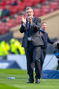 Heart of Midlothian manager Craig Levein applauds his players during the William Hill Scottish Cup semi-final match between Heart of Midlothian and Inverness CT at Hampden Park, Glasgow, United Kingdom on 13 April 2019.