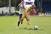 Bury Defender, Craig Jones and Millwall On Loan Midfielder, Chris Taylor  during the Sky Bet League 1 match between Bury and Millwall at the JD Stadium, Bury, England on 23 April 2016. Photo by Mark Pollitt.