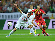 Montenegro's Dejan Damjanovic and Grzegorz Krychowiak of Poland during the FIFA World Cup 2014 group H qualifying football match of Poland vs Montenegro on September 6, 2013 in Warsaw, <br />Photo by: Piotr Hawalej