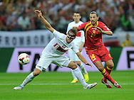 Montenegro's Dejan Damjanovic and Grzegorz Krychowiak of Poland during the FIFA World Cup 2014 group H qualifying football match of Poland vs Montenegro on September 6, 2013 in Warsaw, <br />