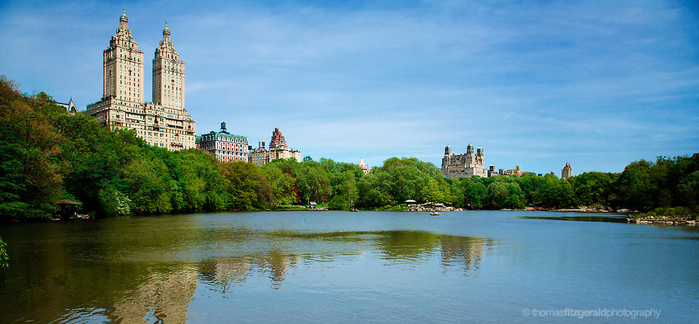 May 2008, New York City, USA, Central Park. The beautiful Surroundings of the Lake in Central Park, NYC, A powerfull view of the city's popular tourist and recreation spot, this image shows the green surroundings of the lake overshadowed by the tall urban buildings of the Upper West Side of manhatten.