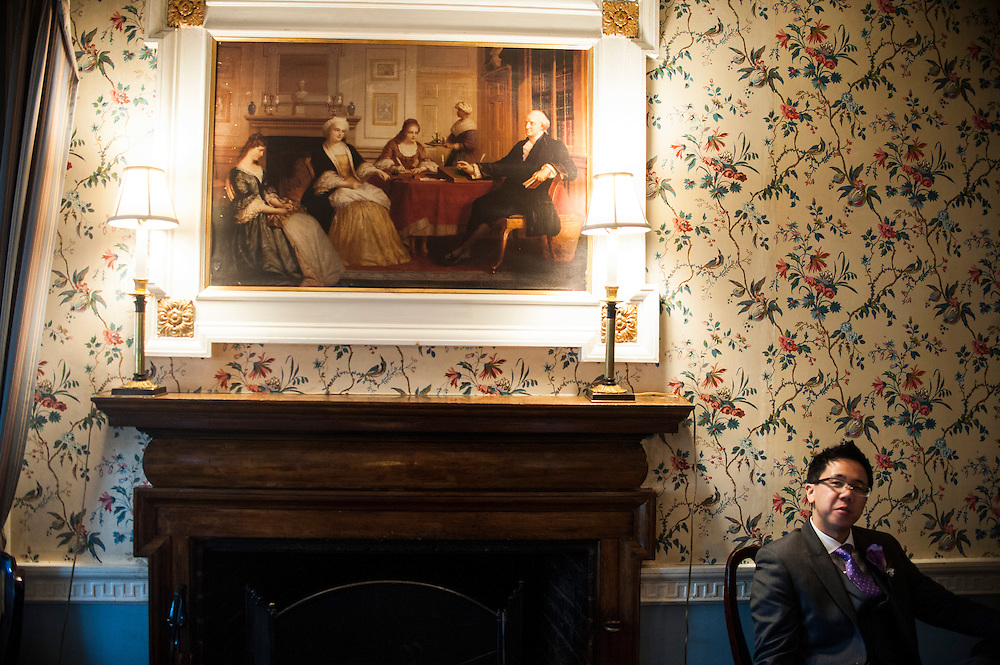 Photo by Matt Roth.Assignment ID: 30140754A..Michael Wong relaxes in the Mount Vernon Inn sitting room before being introduced at their reception at the the Mount Vernon Inn, in Mount Vernon, Virginia on Saturday, April 06, 2013.